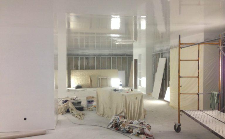 Spraydec shop interior spray painted in white